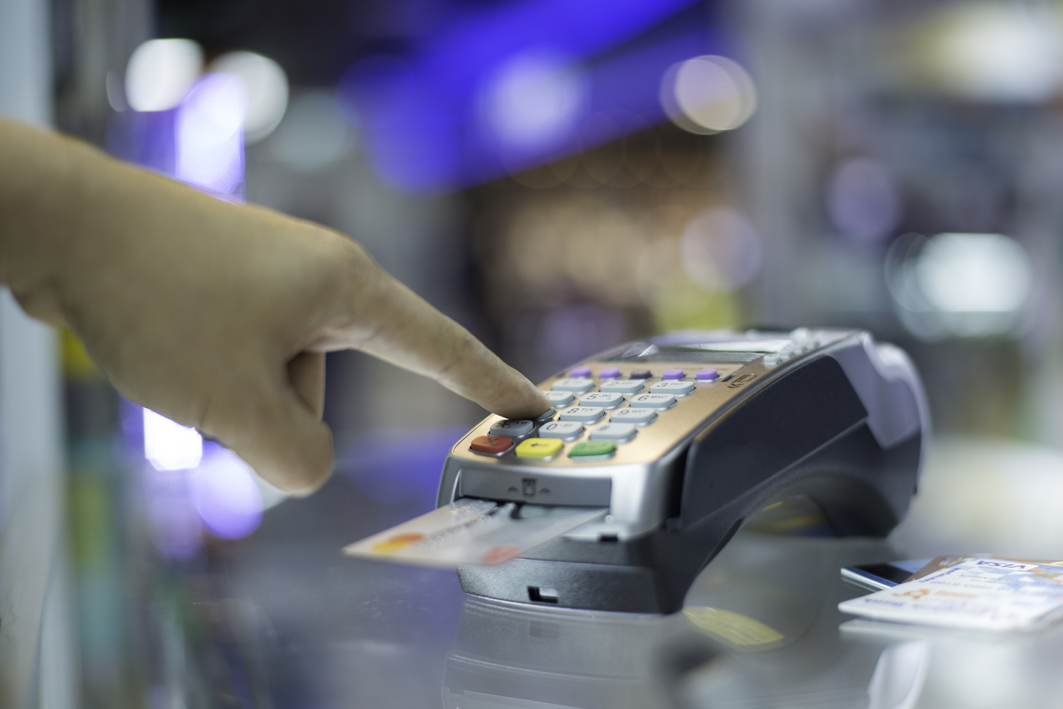 Credit card being used at point of sale register